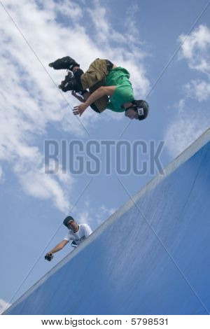 Inline Skater Jumping From Half-pipe.