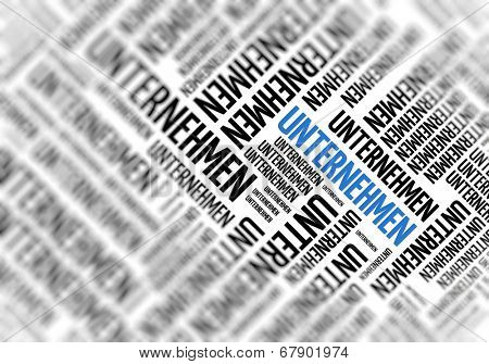 Background with german word - Unternehmen (Company) - repeated in random sizes and orientations in black text with one central word in large blue uppercase lettering and selective focus
