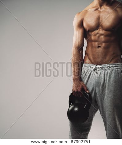 Muscular Young Guy With Kettle Bell