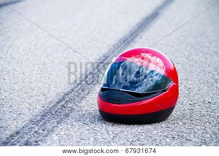 an accident with a motorcycle. traffic accident and skid marks on road. symbol photo.