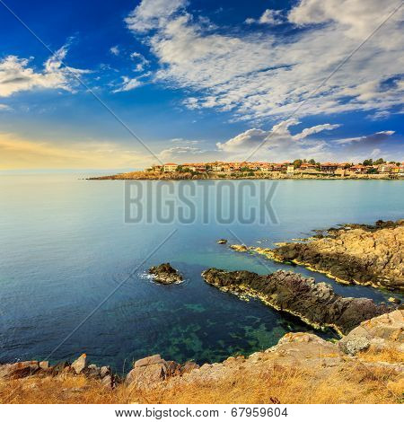 Ancient City On A Rocky Shore Near Sea At Sunrise