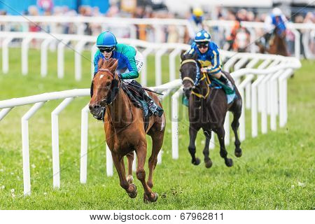 Two Jockeys Out Of The Fourth Curve At The Nationaldags Galoppen