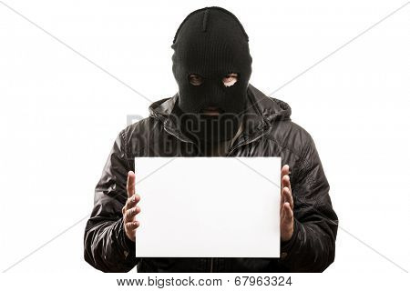 Criminal man in balaclava or mask covering face hand holding blank card white isolated