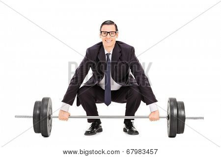 Businessman lifting a heavy weight isolated on white background