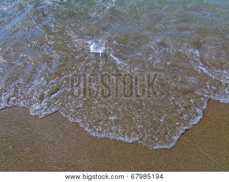 Yellow sand and a sea wave