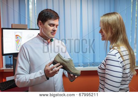 Woman consulting foot doctor