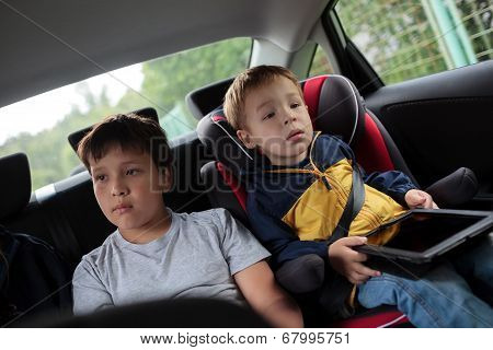 Children sitting in the car and looking at the road