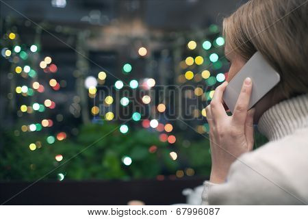 Woman in cafe talking on the phone