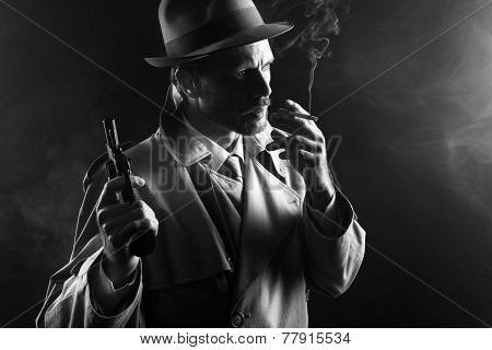 Film Noir: Gangster Smoking And Holding A Gun