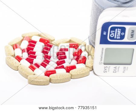 Blood Pressure Device And Tablets In Heart-shaped Arrangement, Symbol Photo Of Heart Disease, Diagno