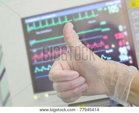 Gloved Hand, Showing Okey Against The Medical Monitor.