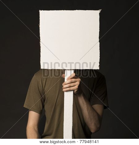 Faceless Person Holding A Blank Sign
