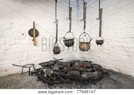 Pots Hanging Over A Fire