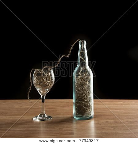 Wine Bottle And Glass Filled With Twine
