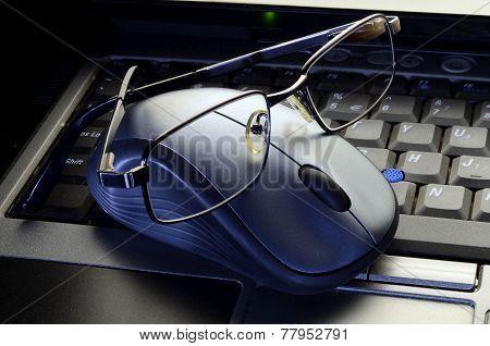 Close Up Computer Mouse With Glasses