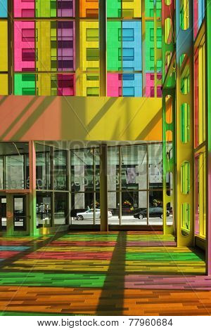 MONTREAL, CANADA - AUGUST 20 2014: Interior of congress center in Montreal downtown with multicolored glass panel created by Mario Saia in 2002