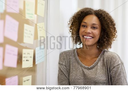 Entrepreneur Smiling In Front Of Her Task Cards