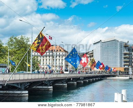 SWITZERLAND, GENEVA - May 11: Bridge with the state flags of country, city and the UN in Geneva, May 11, 2014