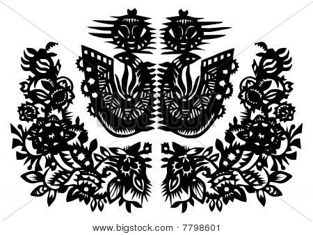 Two black birds and flowers