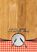 Wooden brown background with checkered tablecloth empty white plate and silver cutlery fork and knife written menu. Template for recipes or a rustic menu poster