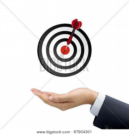 Businessman's Hand Holding Target Button