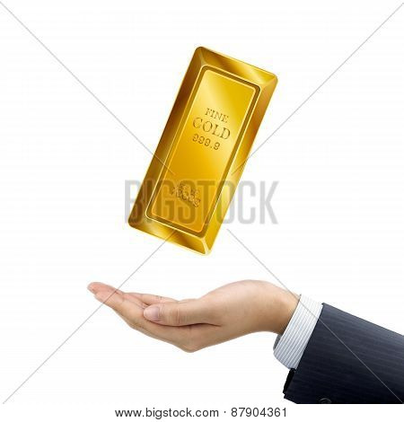 Businessman's Hand Holding Bullion