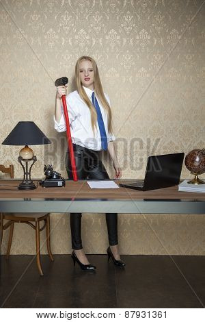 proud business woman with a big hammer poster