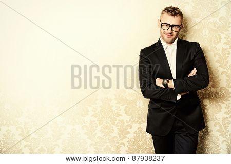 Portrait of a handsome mature man in elegant suit. Fashion, beauty. Copy space.