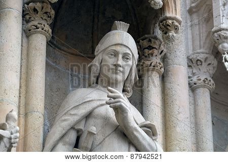 ZAGREB, CROATIA - APRIL 04: Statue of Saint Florian on the portal of the cathedral dedicated to the Assumption of Mary and to kings Saint Stephen and Saint Ladislaus in Zagreb on April 04, 2015