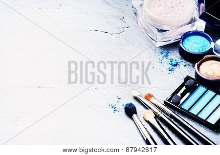 Various Makeup Products In Blue Tone