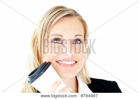 Thoughtful Young Businesswoman Holding A Cup Of Coffee