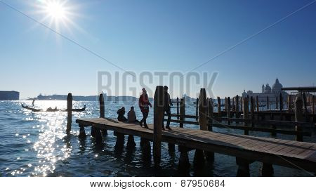 Tourists Visit A Pier In Grand Canel In Venice