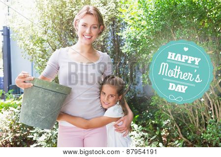 mothers day greeting against mother and daughter tending to flowers