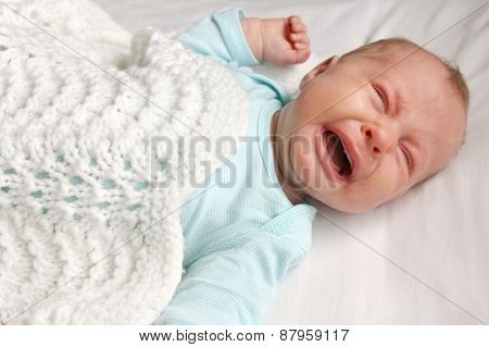 Sweet Newborn Baby Crying In Crib
