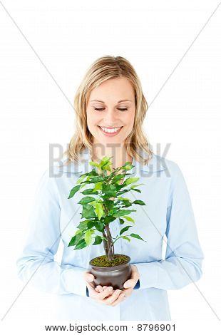 Portrait Of A Charismatic Businesswoman Holding A Plant