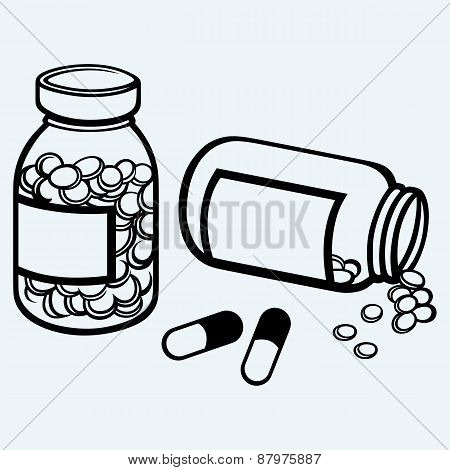 Pill bottle. Spilling pills on to surface