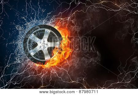 Wheel on fire and water with lightening around on black background. Horizontal layout with text space.