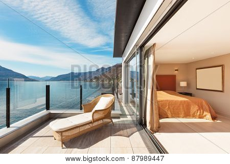 Interior, beautiful modern apartment, bedroom view from balcony