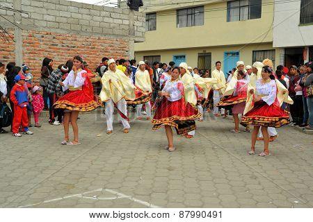 Latacunga, Ecuador 01 October, 2012: Unidentified traditionally clad girls are dancing during La Fiesta de la Mama Negra traditional festival in Latacunga, Ecuador.