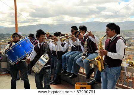 Latacunga, Ecuador 30 September, 2012: Unidentified musicians are playing traditional music at La Fiesta de la Mama Negra traditional festival in  in Latacunga, Ecuador.