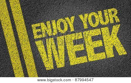 Enjoy Your Week written on the road