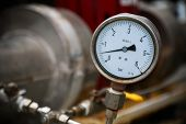 Pressure gauge on oil and gas process for monitored condition. The gauge is one of tools for present or showed condition of process to Operator. poster