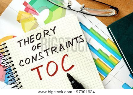 Words Theory of Constraints  TOC  on the notepad and charts.