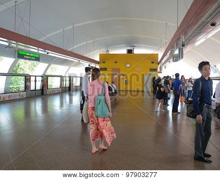 People Waiting For The Train At Mrt Station