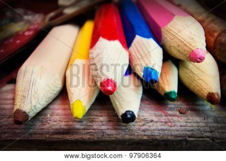 Giant Colour Pencils On A Table