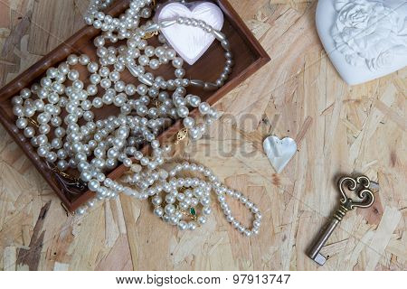 Lot of jewellery close up, with perl