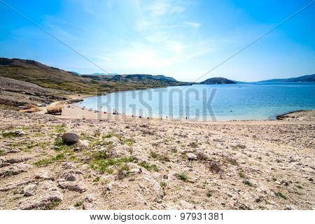 Paradise Adriatic beautiful beach with stone and sea blue and green colors. Isolated beach as a vacation destination and Robinson tourism in Mediterranean poster