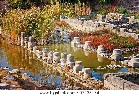 Drowned columns in Letoon - sanctuary of Leto goddess near the ancient Lycian city Xanthos, Turkey poster