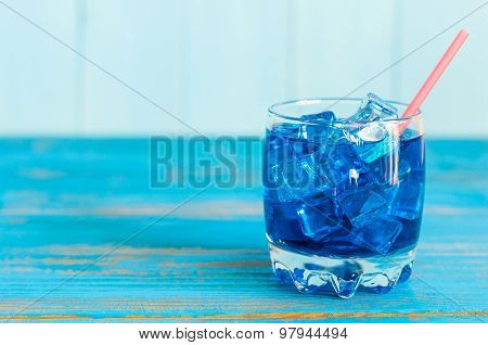 Blue Lagoon cocktail on light background, with empty space for text
