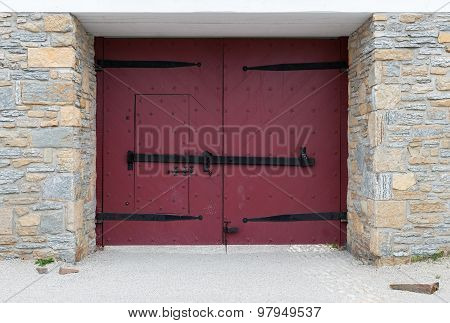 Red Doors In Stone Wall